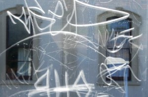 Etching caused by vandalism is very costly.